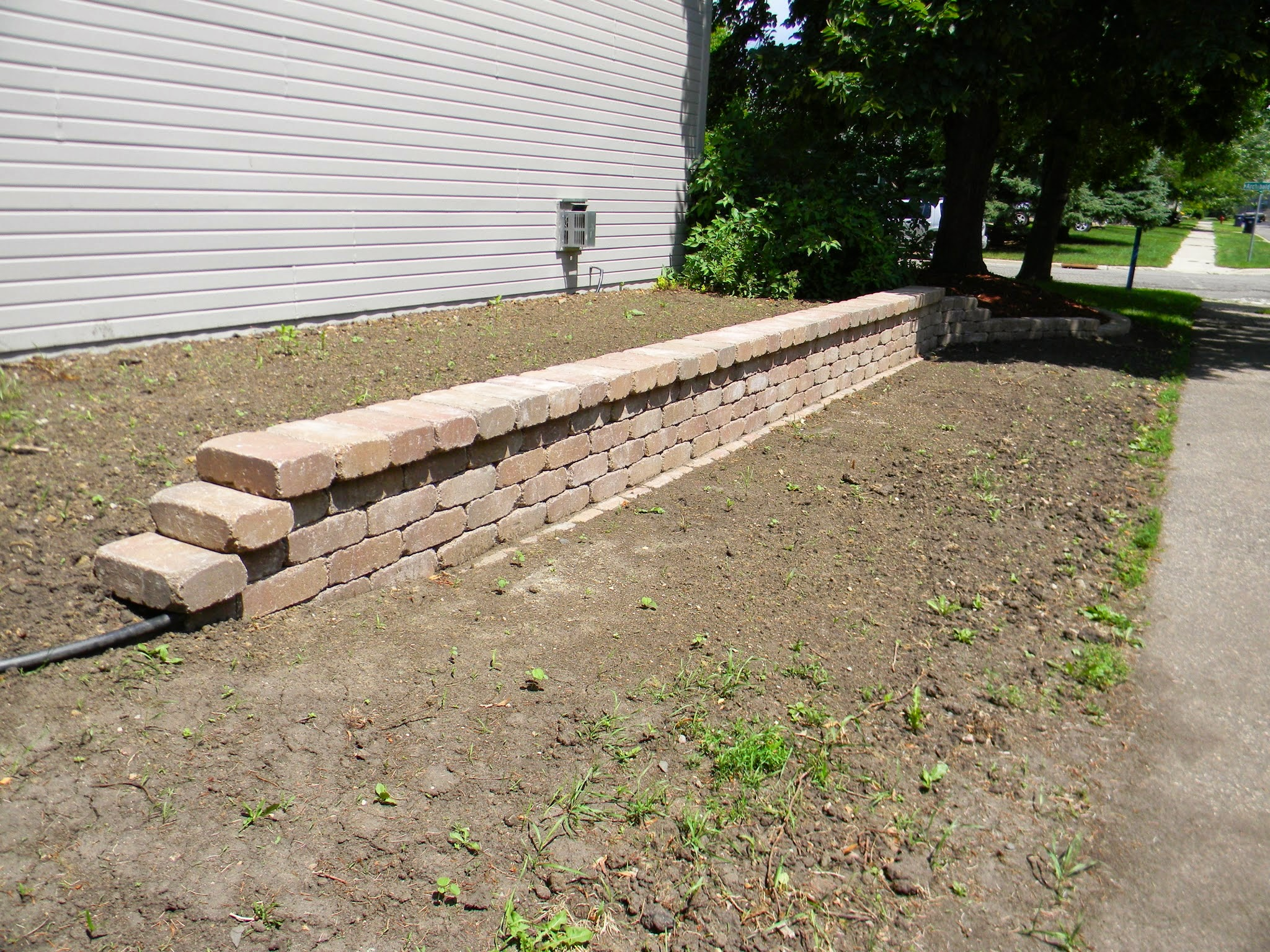 how to build short retaining wall with ties
