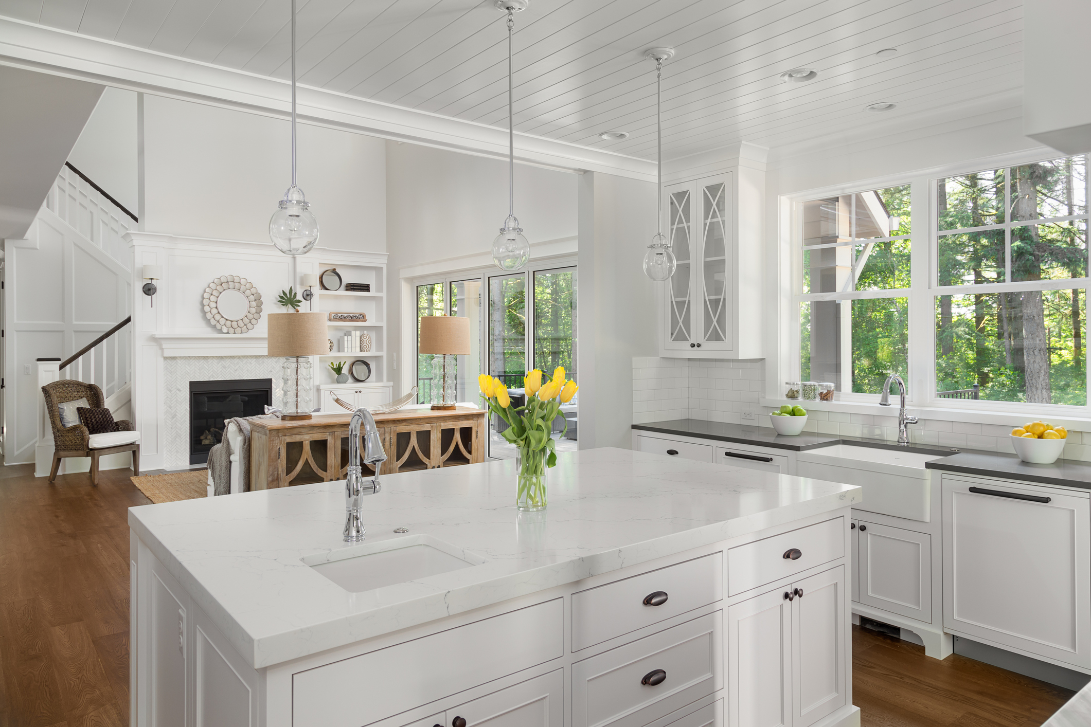 white-kitchen-interior-and-living-room-in-luxury-home.jpg