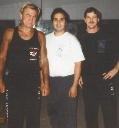 Larry Hartsell (original student of Bruce Lee) on the left, DaSilva Sensei in the center, and Sifu Cliff Sons on the right.